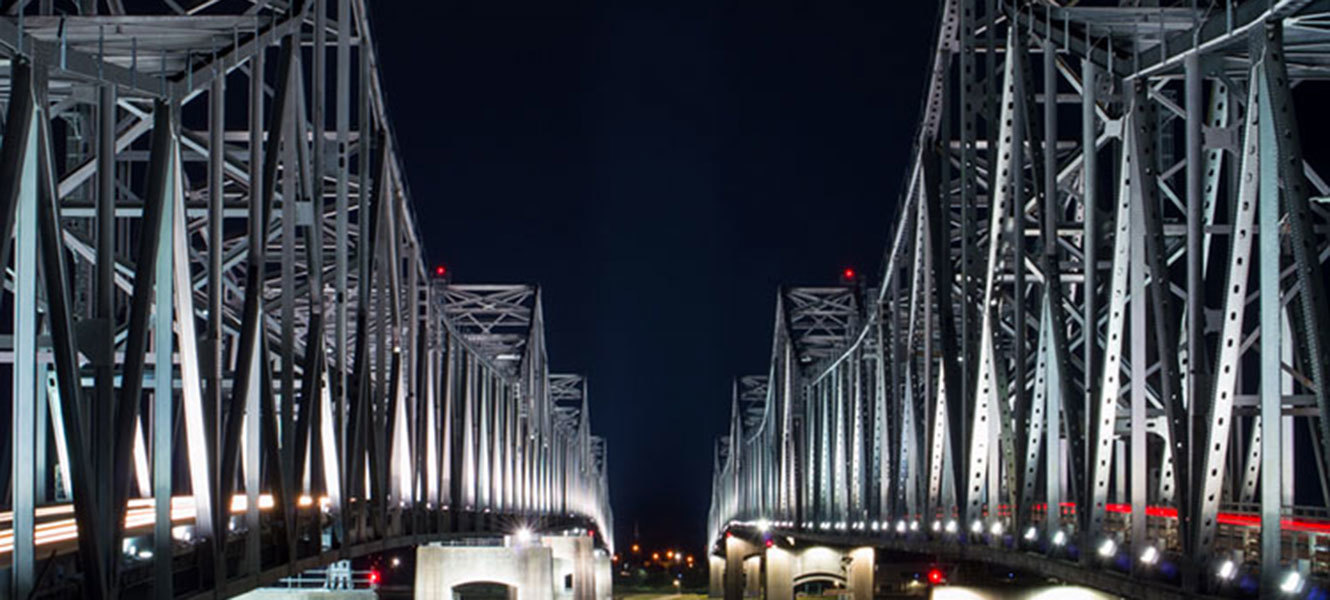 Photo of twin, well lit bridges spanning the Mississippi river